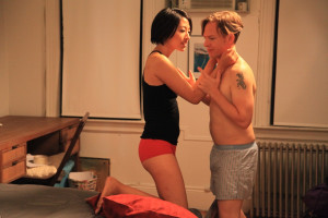 J.P. Porter (J.D.Oxblood) isn't sure he wants to fool around with the girl he brought home (Melody Cheng).
